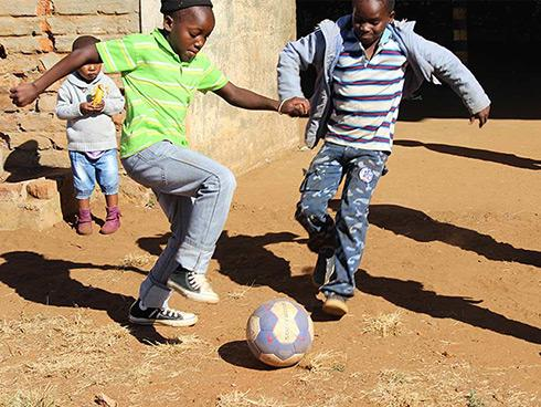 Children play as a result of the passback program
