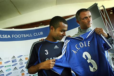 ahsley cole shows off his number 3 jersey for chelsea